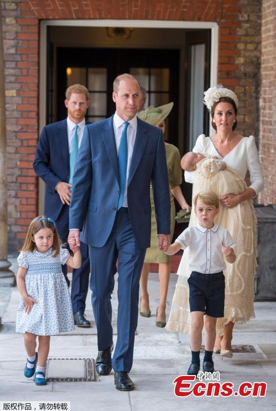 Britain\'s Princess Charlotte and Prince George hold the hands of their father, William, the Duke of Cambridge, as they arrive for the christening of their brother, Prince Louis, who is being carried by their mother, Catherine, the Duchess of Cambridge, at the Chapel Royal, St James\'s Palace, London, Britain, July 9, 2018.(Photo/Agencies)