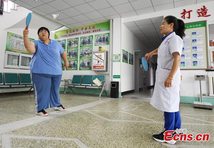 Guo Dengyan, a former judo athlete, plays table tennis at a weight management center in Changchun City, Northeast China's Jilin Province. Guo, from a sports family, played and studied basketball, table tennis, weightlifting and judo since she was six, but she also faced the challenge of controlling her weight. Now 28 years old and 200 kilograms, she said she also learned traditional Chinese culture to control her emotions and be optimistic in life. (Photo: China News Service/Zhang Yao)