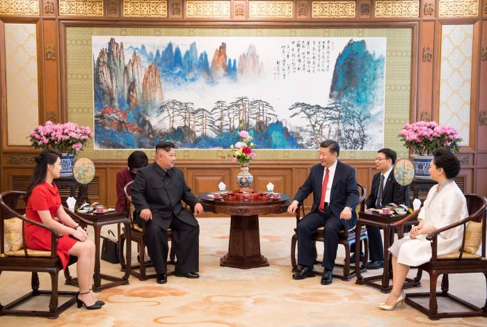 June 20, 2018   President Xi Jinping drinks tea with Kim Jong-un, top leader of the Democratic People's Republic of Korea, at the Diaoyutai State Guesthouse in Beijing, following the easing of tensions surrounding the nuclear issue in the Korean Peninsula. This cup of tea is a great representation of the concept of peace. (Photo/Xinhua)
