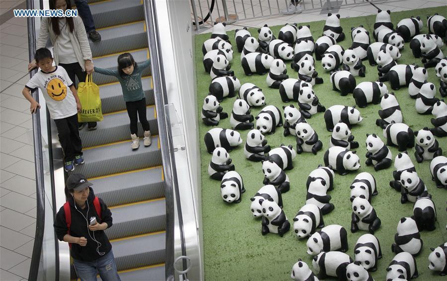 Photo taken on July 10, 2018 shows papier-mache pandas during an exhibition of the papier-mache artwork \