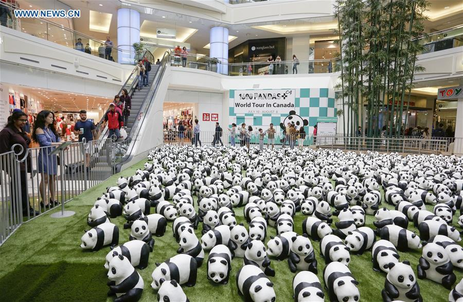 <?php echo strip_tags(addslashes(Photo taken on July 10, 2018 shows papier-mache pandas during an exhibition of the papier-mache artwork