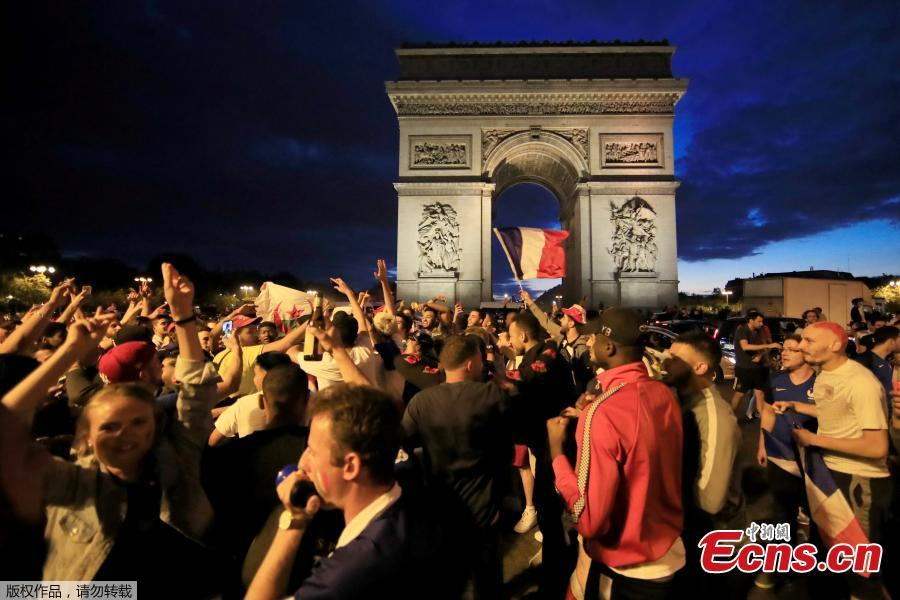 France fans react on the Champs-Elysees in Paris, France, July 10, after defeating Belgium 1-0 in their World Cup semi-final match in St Petersburg. It means the 1998 World Cup winners will play either England or Croatia in the final on Sunday. (Photo/Agencies)
