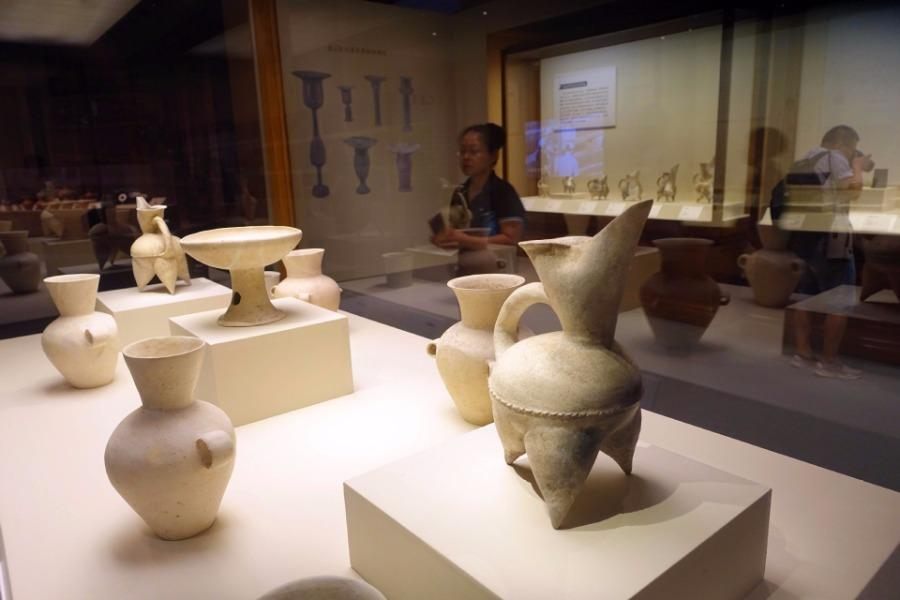 An exhibition featuring Jiaojia relics was unveiled at the National Museum of China on July 10. The exhibition consists of over 230 artifacts, most of which come from the Zhangqiu Jiaojia ruins in Shandong Province. The heritage site was listed as a top 10 archaeological discovery in China in 2017. (Photo/Xinhua)  Covering an area of nearly 150,000 square meters, the relics reveal an extremely rich cultural heritage, including rammed earth walls, ditches, 215 tombs, 116 house sites as well as burial objects such as jade bracelets, pottery cups, white pottery and painted pottery.  The Jiaojia relics site is a link between the preceding Xihe culture of the middle Neolithic Age and the subsequent Longshan and Yueshi cultures. The unearthing filled a gap in the study of residential patterns in the middle and late stage of Dawenkou culture.