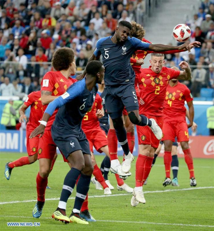 Olivier Giroud (L) of France shoots during the 2018 FIFA World Cup semi-final match between France and Belgium in Saint Petersburg, Russia, July 10, 2018. (Xinhua/Lu Jinbo)