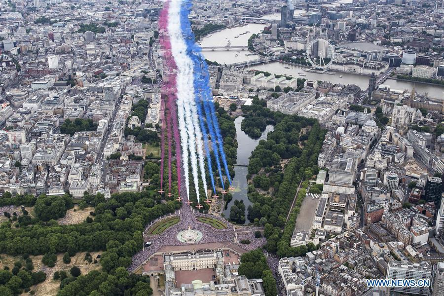 The Red Arrows fly over central London during a celebration to mark the 100th anniversary of the Royal Air Force (RAF) in London, Britain on July 10, 2018. (Xinhua/Britain\'s Ministry of Defence)