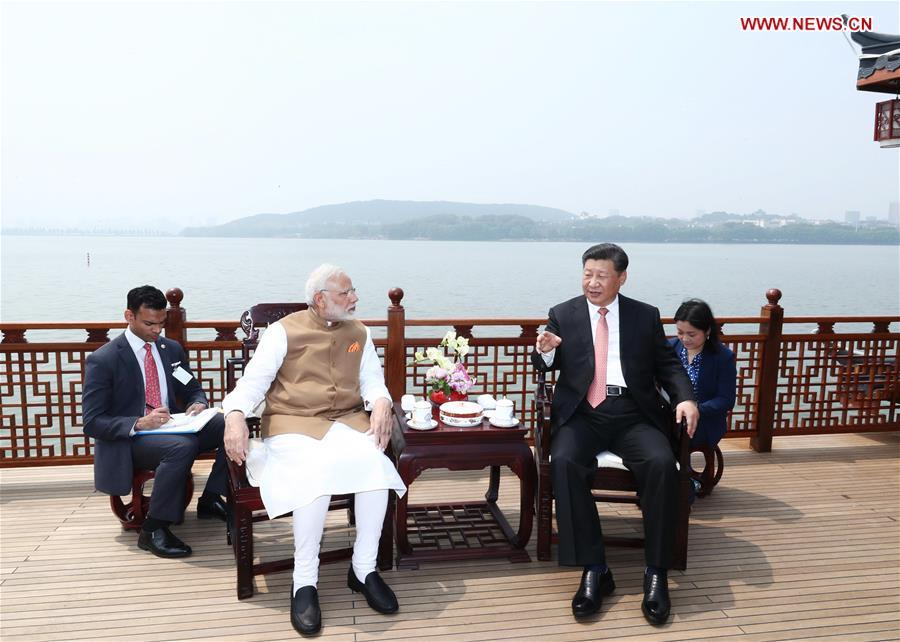 April 28, 2018   President Xi Jinping talks with Indian Prime Minister Narendra Modi in Wuhan, Central China\'s Hubei Province, ahead of the start of the Shanghai Cooperation Organization summit in June and at an important juncture for the progress of China-India relations. (Photo/Xinhua)  During the meeting, Xi and Modi tried two types of local tea, Lichuan black tea and Enshi green tea. Xi also mentioned that another type of tea from Yichang, Hubei, had ties with India. With exchanges between China and India in trade and culture dating far back, President Xi emphasized that China and India should expand and deepen exchanges, be committed to the rejuvenation of Eastern civilization, call for respect for cultural diversity, and promote the harmonious coexistence of different civilizations.