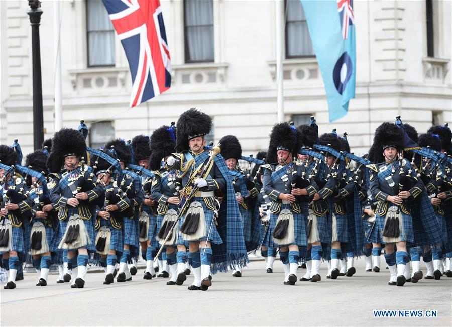 The Royal Air Force (RAF) Pipes and Drums band take part in a parade to mark the 100th anniversary of RAF in London, Britain on July 10, 2018. (Xinhua/Britain\'s Ministry of Defence)
