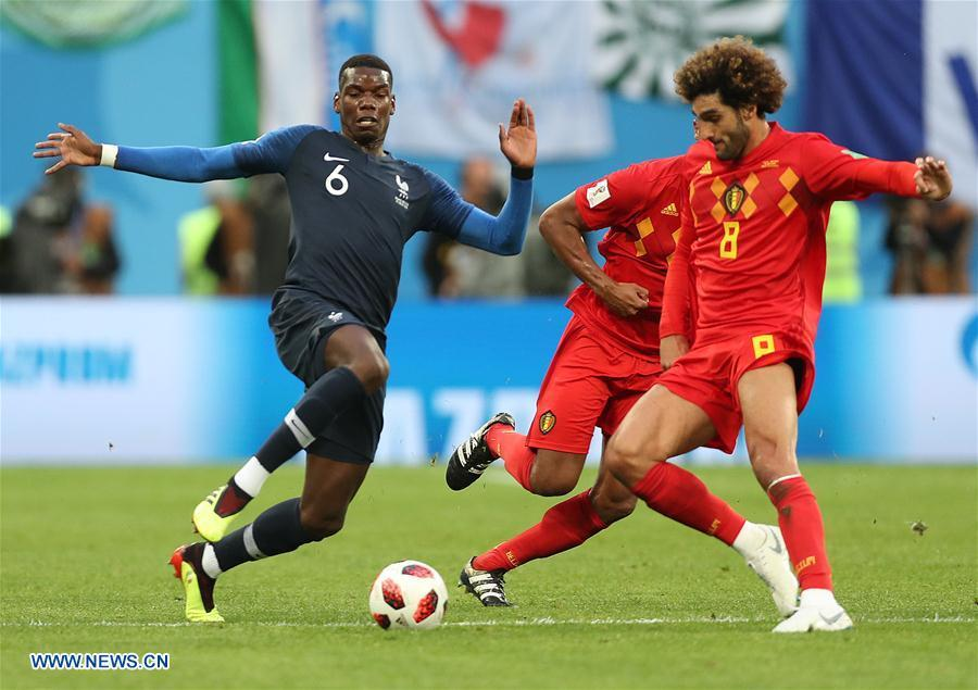 Kevin De Bruyne (C) of Belgium vies with Antoine Griezmann (R) and Blaise Matuidi of France during the 2018 FIFA World Cup semi-final match between France and Belgium in Saint Petersburg, Russia, July 10, 2018. (Xinhua/Li Ming)