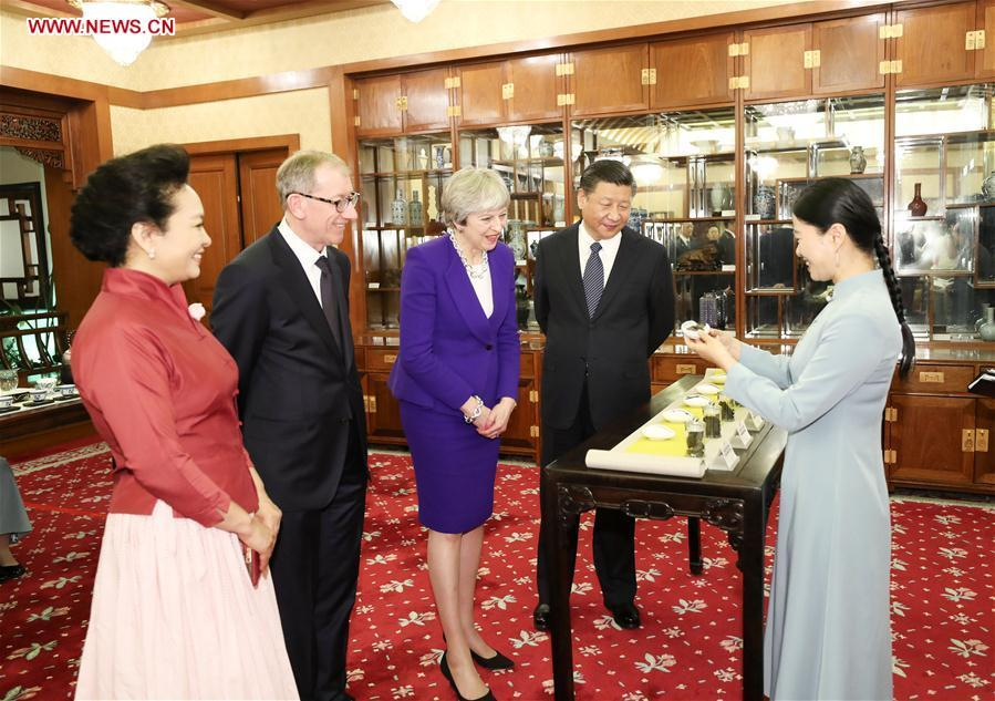 Feb. 1, 2018   President Xi Jinping and his wife Peng Liyuan, and visiting British Prime Minister Theresa May and her husband Philip May, have afternoon tea in Beijing.  (Photo/Xinhua)