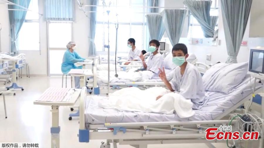 In this image made from video, released by the Thailand Government Spokesman Bureau, three of the 12 boys are seen recovering in their hospital beds after being rescued along with their coach from a flooded cave in Mae Sai, Chiang Rai province, northern Thailand. (Photo/Agencies)