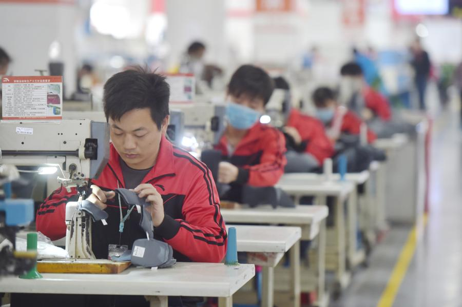 Workers at Anta Sports in Jinjiang, Fujian Province, on Feb 24, 2018. (Photo/Xinhua)