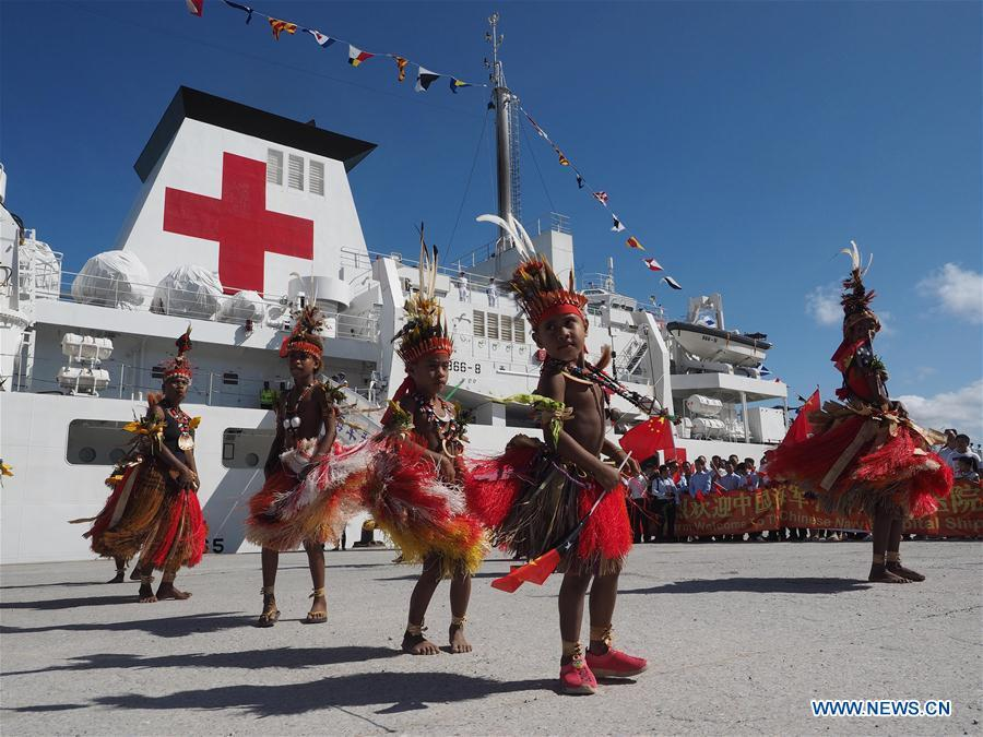 People perform traditional dance to welcome Chinese naval hospital ship Ark Peace in Port Moresby, Papua New Guinea, on July 11, 2018. Chinese naval hospital ship Ark Peace arrived in Papua New Guinea\'s capital Port Moresby on Wednesday, marking the start of its eight-day humanitarian mission in the Oceanian nation. (Xinhua/Jiang Shan)