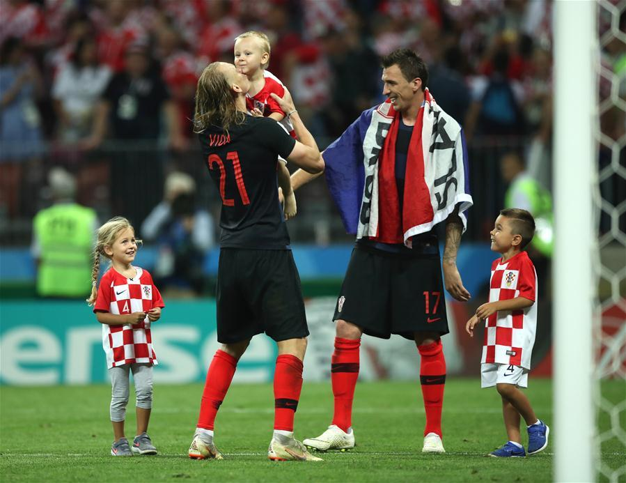 Croatia\'s Domagoj Vida (2nd L) and Mario Mandzukic (2nd R) celebrate victory after the 2018 FIFA World Cup semi-final match between England and Croatia in Moscow, Russia, July 11, 2018. Croatia won 2-1 and advanced to the final. (Xinhua/Wu Zhuang)