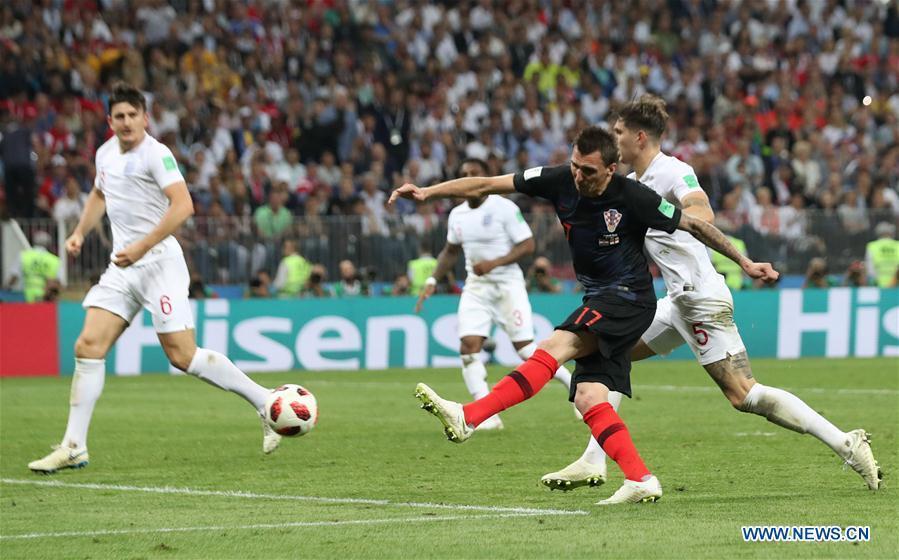 Mario Mandzukic (2nd R) of Croatia shoots to score during the 2018 FIFA World Cup semi-final match between England and Croatia in Moscow, Russia, July 11, 2018. (Xinhua/Cao Can)