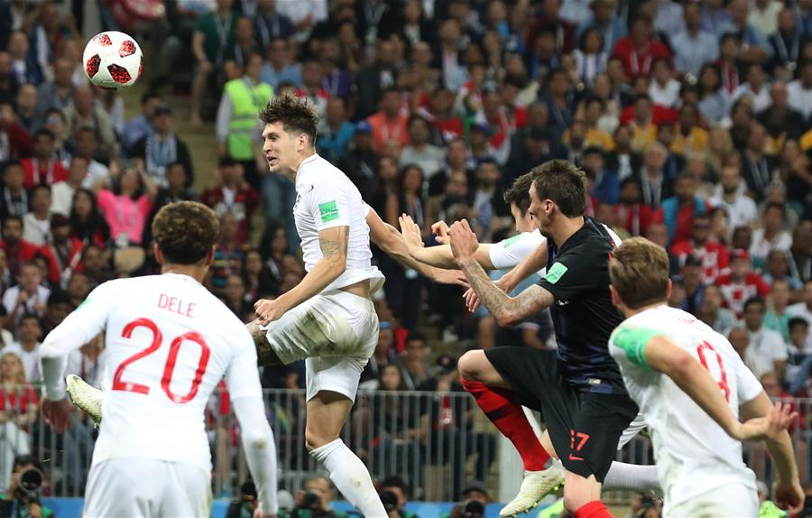 John Stones (top) of England competes for a header during the 2018 FIFA World Cup semi-final match between England and Croatia in Moscow, Russia, July 11, 2018. (Xinhua/Cao Can)