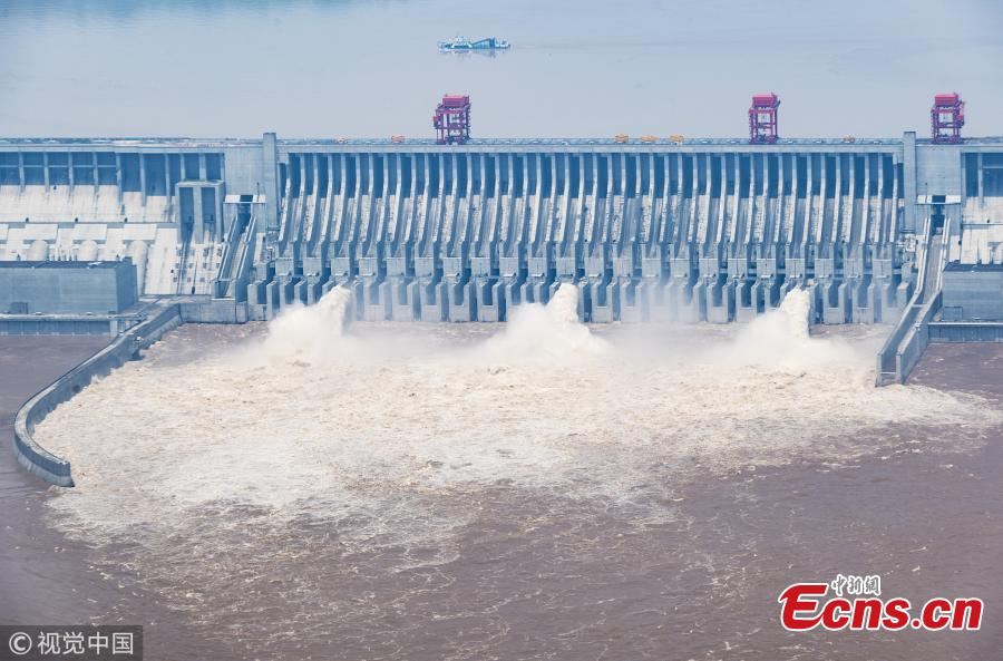 Water gushes out of the Three Gorges Dam in Yichang City, Central China's Hubei Province. On July 14, the Three Gorges Reservoir will receive a massive 60, 000 cubic meters of water a second due to heavy rain in the upper reaches of the Yangtze River. Authorities have issued a flood alert in several provinces along the river. (Photo/VCG)