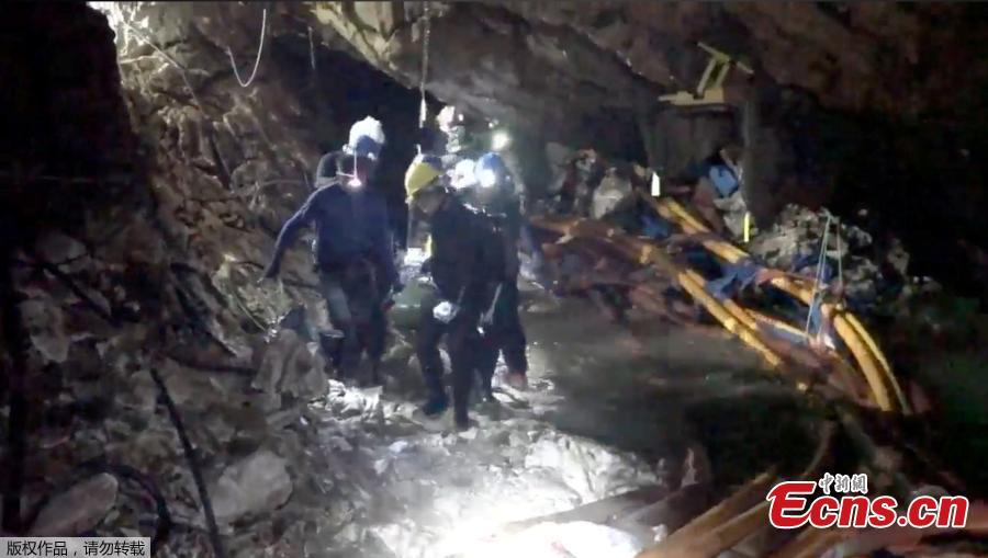 This undated image from video released via the Thai NavySEAL Facebook Page on July 11, 2018, shows rescuers hold an evacuated boy inside the Tham Luang Nang Non cave in Mae Sai, Chiang Rai province, in northern Thailand. A daring rescue mission in the treacherous confines of a flooded cave in northern Thailand has saved all 12 boys and their soccer coach who were trapped deep within the labyrinth, ending a grueling 18-day ordeal that claimed the life of an experienced volunteer diver and riveted people around the world. (Photo/Agencies)