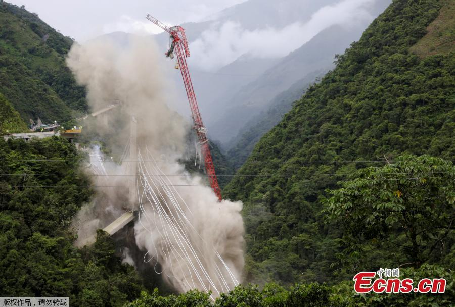 A view of Chirajara bridge at the Villavicencio city is seen during the controlled destruction, on July 11, 2018 in Bogota, Colombia. Implosion for the remains in the south part of the cable bridge was carried out with explosives. The bridge that was under construction was collapsed on January. Nine construction workers were died and eight were injured. (Photo/Agencies)