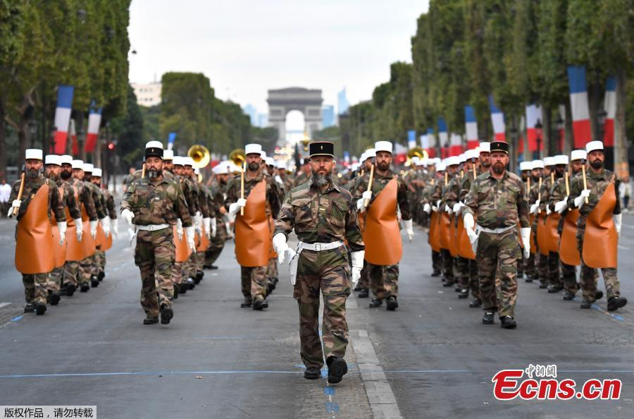 Soldiers of the French Foreign Legion parade on the Champs Elysees avenue during a rehearsal for Bastille Day, early Wednesday, July 11, 2018 in Paris, France. (Photo/Agencies)