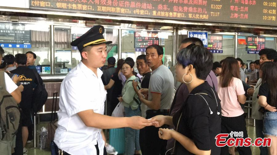 Railway passengers wait to get a refund in Xi'an City, Northwest China's Shaanxi Province, July 13, 2018, after the Baoji-Chengdu railway line was cut off due to landslide in Lueyang County, Northwest China's Gansu Province. Local railway authorities have mobilized thousands of people to resume train operations. (Photo provided to China News Service)