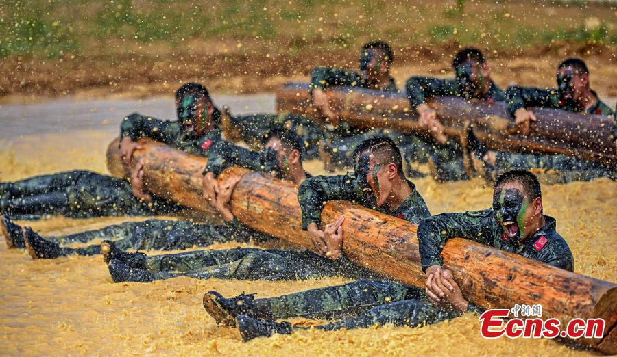 Armed police officers receive intensive training as temperatures hit 35 degrees centigrade in Xuancheng City, East China's Anhui Province, July 12, 2018. The one-week training included skills in search and rescue in a mountain setting, shooting, and swimming across a river in combat gear. (Photo: China News Service/Ye Jingwen)