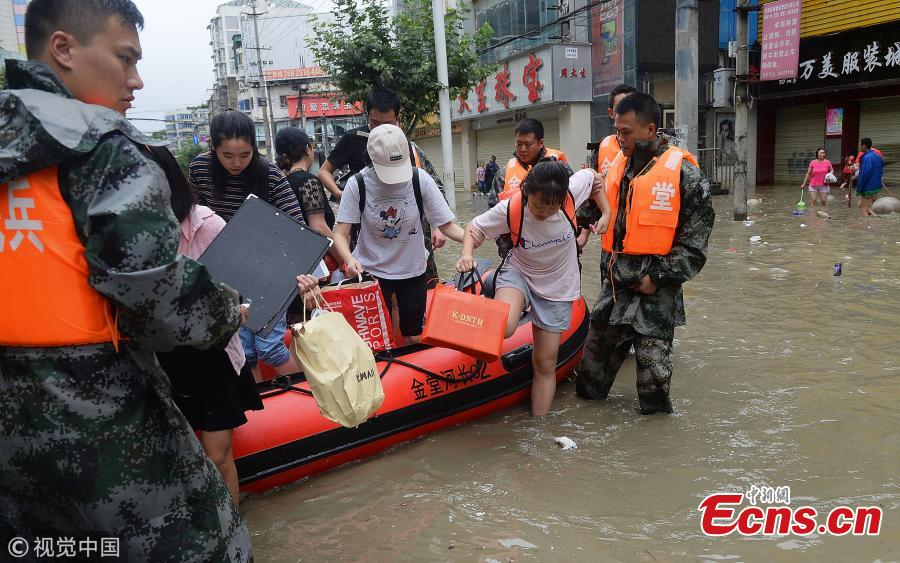 A rubber boat transports people on a flooded street in Jintang County, Southwest China's Sichuan Province, July 12, 2018, after heavy rain. (Photo/VCG)
