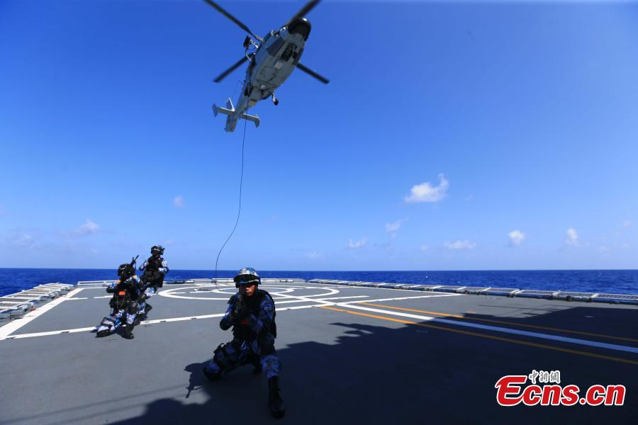 Chinese soldiers train on the Binzhou frigate, the commanding ship of China\'s 29th naval escort fleet for anti-piracy missions in the Gulf of Aden and Somali waters. The training included shooting practice and abseiling from a helicopter. (Photo: China News Service/Jin Hang)