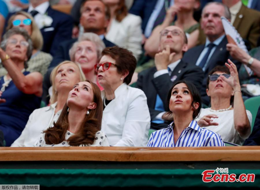 Britain\'s Catherine the Duchess of Cambridge and Meghan the Duchess of Sussex watch Spain\'s Rafael Nadal continue his semi final match against Serbia\'s Novak Djokovic, which was suspended yesterday, after running late, at the Wimbledon Tennis Championships, in London, Britain, July 14, 2018. (Photo/Agencies)