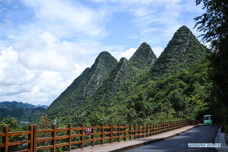 Photo taken on July 15, 2018 shows karst hills within the Wanfenglin scenic area in Xingyi, southwest China\'s Guizhou Province. (Xinhua/Tao Liang)