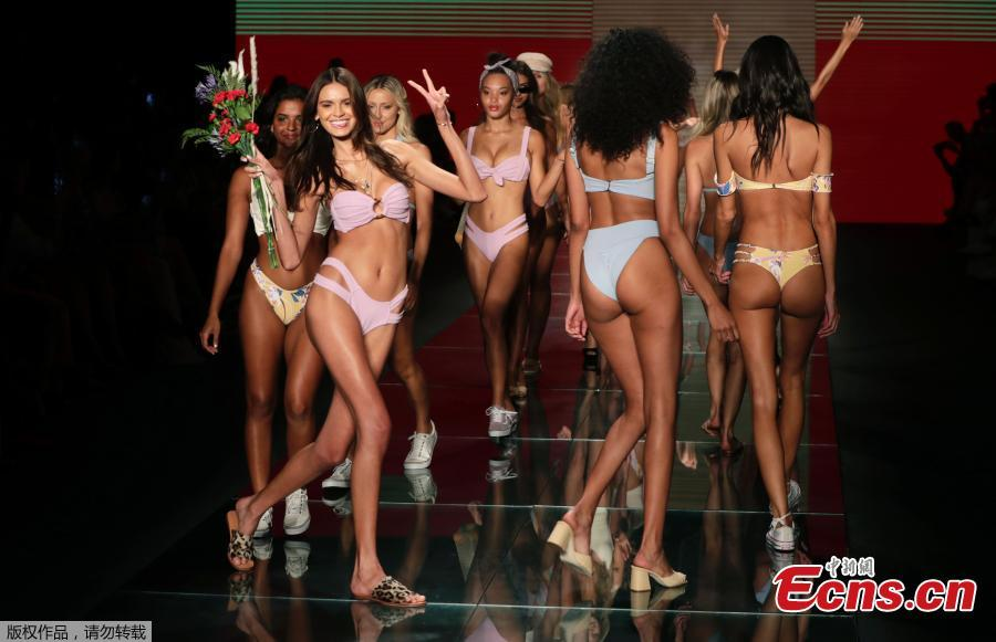 Models walk down the runway during the Montce swimwear show at Miami Swim Week, July 15, 2018, in Miami Beach, Florida. (Photo/Agencies)