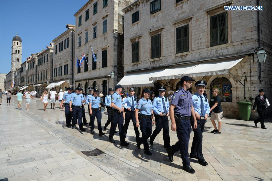 Chinese and Croatian police officers patrol after the launching ceremony of joint police patrol between China and Croatia in the Old Town of Dubrovnik, Croatia, on July 15, 2018. Six uniformed Chinese police officers started joint patrol with their Croatian counterparts here on Sunday. (Xinhua/Gao Lei)