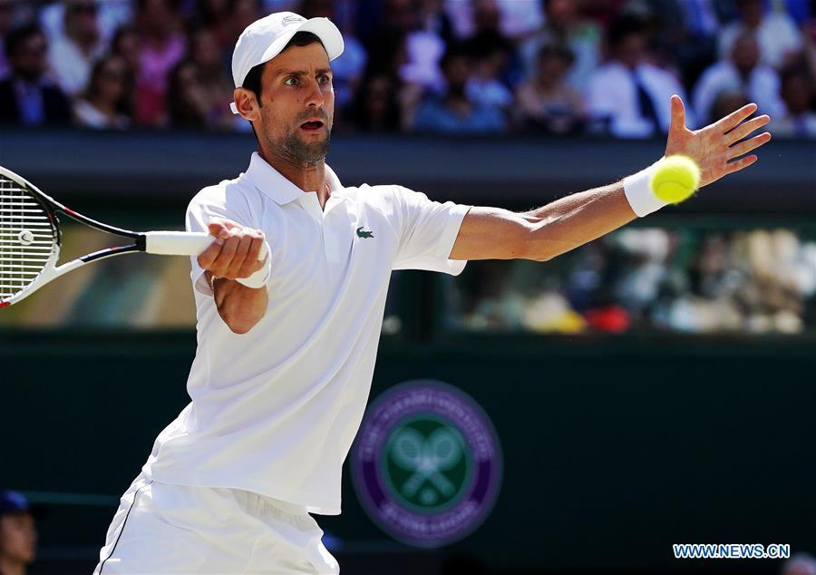 Novak Djokovic of Serbia hits a return during the men\'s singles final match against Kevin Anderson of South Africa at the Wimbledon Championships 2018 in London, Britain, on July 15, 2018. (Xinhua/Guo Qiuda)