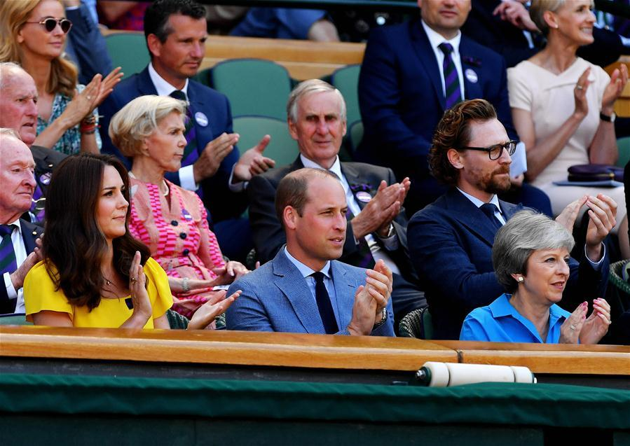 British Prime Minister Theresa May (Front, R), Prince William (Front, C), Duke of Cambridge, and his wife Catherine(Front, L), Duchess of Cambridge, are seen during the men\'s singles final match between Novak Djokovic of Serbia and Kevin Anderson of South Africa at the Wimbledon Championships 2018 in London, Britain, on July 15, 2018. (Xinhua/Guo Qiuda)