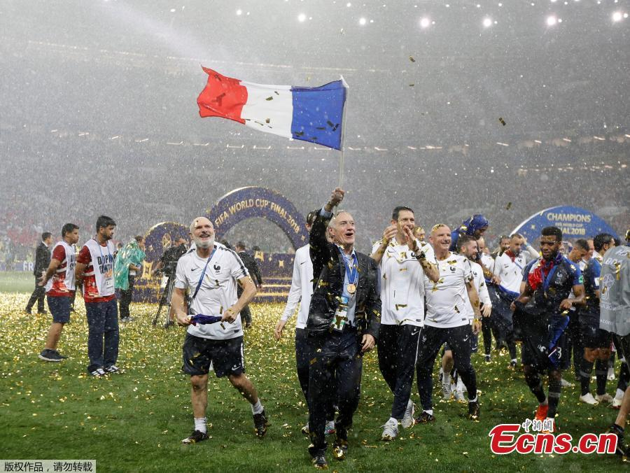 France coach Didier Deschamps and backroom staff celebrate winning the World Cup at Luzhniki Stadium in Moscow, Russia, July 15, 2018. (Photo/Agencies)