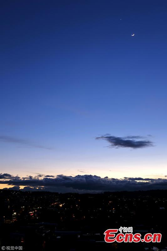 Venus (above) appears in the night sky near a crescent moon on July 15, 2018 in Bogota, Colombia. The conjunction of the planet Venus was seen next to the crescent moon and the regulus star from sunset to sunrise. (Photo/VCG)