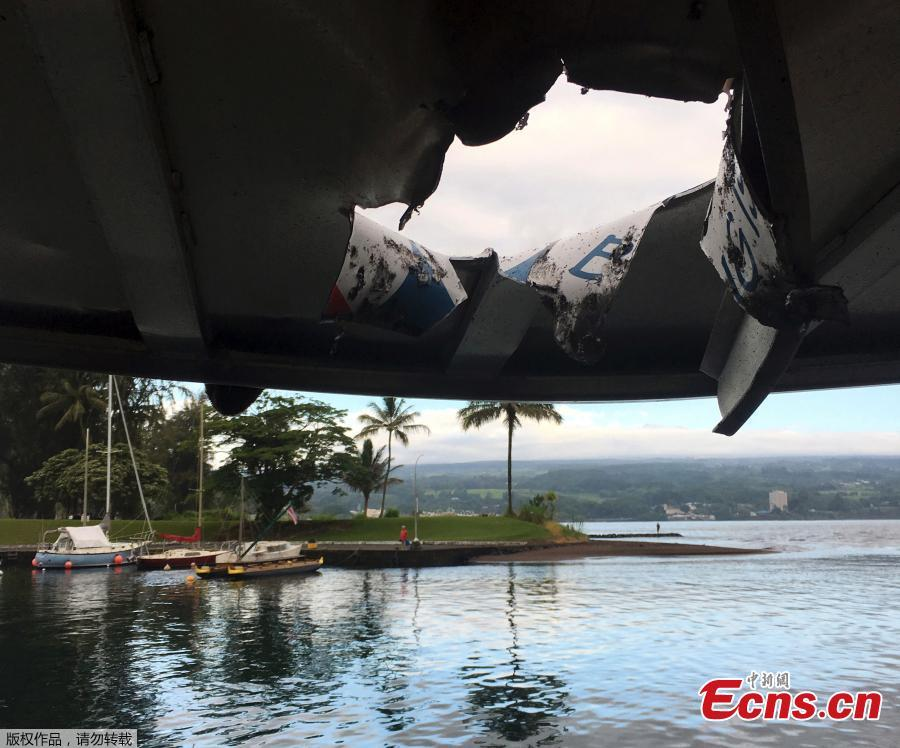 This photo provided by the Hawaii Department of Land and Natural Resources shows damage to the roof of a tour boat after an explosion sent lava flying through the roof off the Big Island of Hawaii Monday, July 16, 2018, injuring at least 23 people. The lava came from the Kilauea volcano, which has been erupting from a rural residential area since early May. (Photo/Agencies)