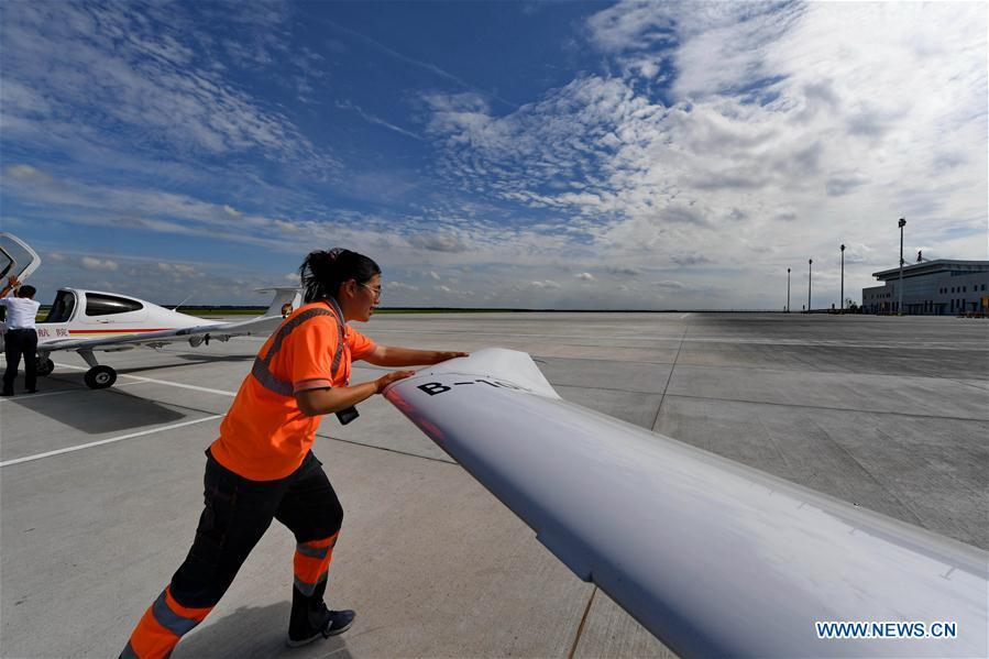 Deng Yun pushes an aircraft to a specific place at the Chagan Lake airport in Songyuan, northeast China\'s Jilin Province, July 17, 2018. Deng was born in 1991. She is an aircraft maintenance technician of an aviation academy in Jilin. The young female engineer and other nine colleagues are in charge of training plane maintenance at the airport. To ensure the flight safety, they need to check more than 100 items before a plane takes off. (Xinhua/Zhang Nan)