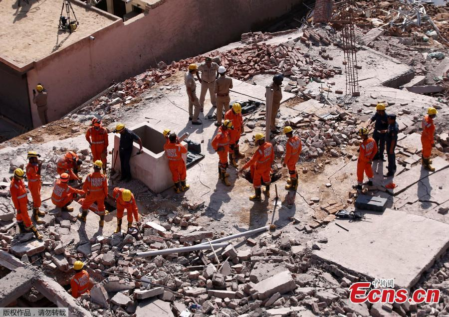 Rescue workers look for survivors amidst the rubble at the site of a collapsed residential building at Shah Beri village in Greater Noida, India, July 18, 2018. Police said that most of the people feared trapped are laborers working at the site. India Today reported that a National Disaster Response Force (NDRF) team has also been rushed to the spot. The news channel further said that as many as 20 people are feared trapped in the debris. (Photo/Agencies)
