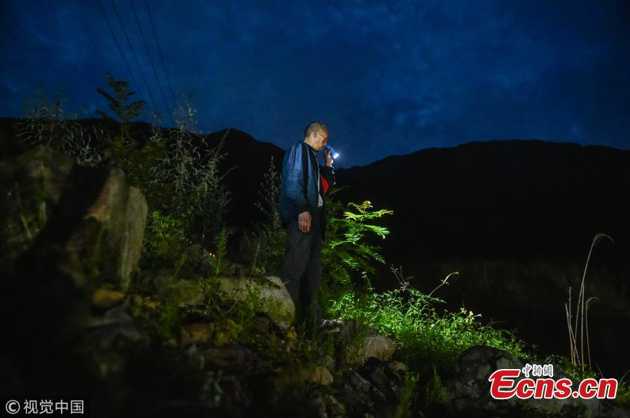 Mou Huaiqing, 65, patrols a valley at night in Dujiangyan City, Southwest China's Sichuan Province. For the past nine years, since the deadly May 12 earthquake in 2008, Mou and his colleagues have been responsible for 24-hour monitoring of the valley from May to October for signs of potential landslides that could pose a threat to local villagers. They check for any cracks on mountain slopes, for example. Mou helped evacuate 300 residents and tourists in a timely manner as he sounded an alarm to warn of a landslide in August 2010. The team has sounded warnings for a dozen geological hazards. (Photo/VCG)