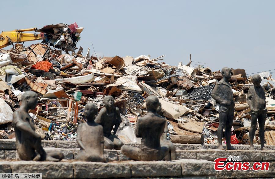 Household waste, caused by a flooding, are piled up at a temporary waste-collection point in Kurashiki, Okayama Prefecture, Japan, July 14, 2018. (Photo/Agencies)