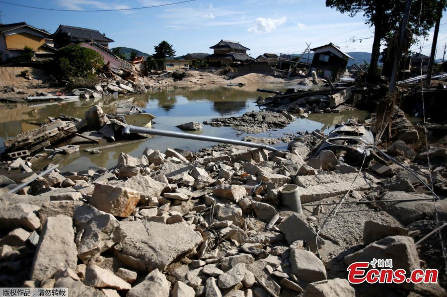 Submerged and destroyed houses are seen near the site where river banks were broken along Suemasa river in Mabi town in Kurashiki, Okayama Prefecture, Japan, July 9, 2018.(Photo/Agencies)