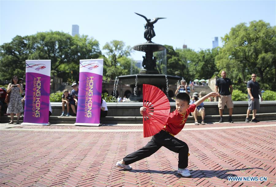 A boy performs martial arts during a traditional dragon boat awakening ceremony for the 28th annual Hong Kong Dragon Boat Festival in New York, the United States, on July 18, 2018. The ceremony marked the start of the training period for over 200 teams competing in this year\'s dragon boat races on Aug. 11 and Aug. 12 in New York. (Xinhua/Wang Ying)