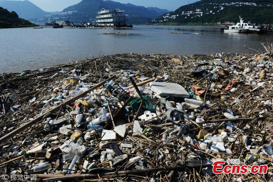 Garbage piles up on the banks of the Yangtze River after floodwaters subside in Yunyang County, Southwest China's Chongqing Municipality, July 17, 2018. Over 1,500 tons of garbage were cleaned up a day. The Three Gorges Reservoir received a massive 60, 000 cubic meters of water a second after heavy rain in the upper reaches of the Yangtze River. Local authorities have warned more heavy rain and floods are expected to hit the Three Gorges Reservoir this year.  (Photo/VCG)