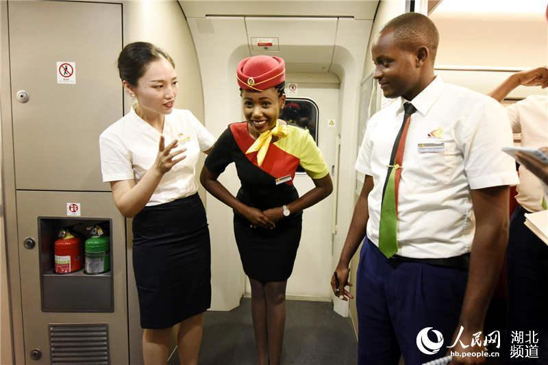 Ceremonial training (Photo/hb.people.cn)  Four train attendants from the Mombasa-Nairobi SGR Operation Co took an educational ride on China\'s G555 high-speed train, which runs from Beijing to Wuhan.  They had been sent by their company to study from their Chinese counterparts, with the aim of improving service on Kenya\'s standard gauge railway (SGR).  They immersed themselves in the operations, service languages and ceremonial standards of their Chinese counterparts.  \