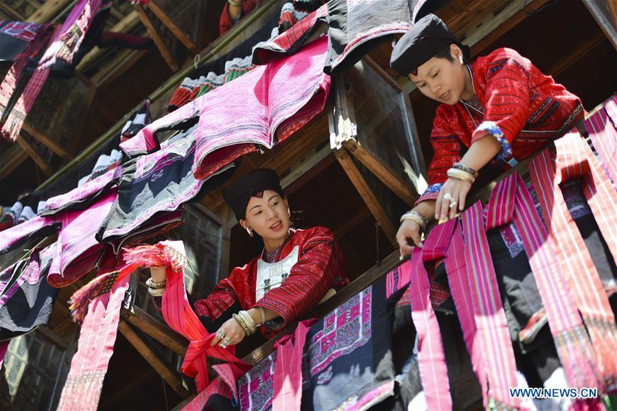 Women of Yao ethnic group present folk costumes in Longji Township of Guilin, south China\'s Guangxi Zhuang Autonomous Region, July 18, 2018. Local people of Yao ethnic group on Wednesday celebrated annual \