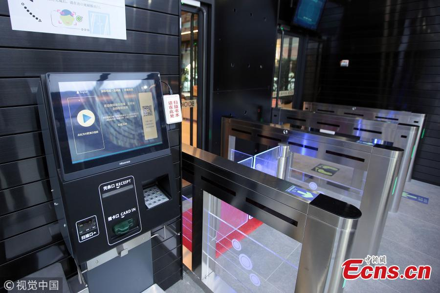 A smart, unmanned bookstore opens in Shenzhen City, South China's Guangdong Province, July 18, 2018. The 178-sqm bookstore, the largest unmanned bookstore in China, allows customers to process their payments using facial recognition technology. After scanning a code to enter the bookstore, customers can find the precise location of a book and complete payment through Tencent's popular social networking app WeChat. (Photo/VCG)