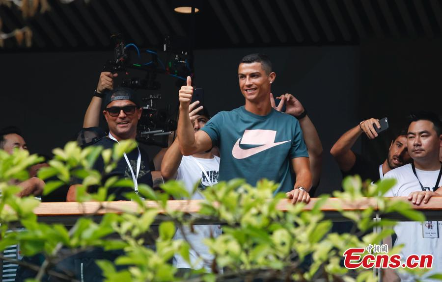 Portuguese professional footballer Cristiano Ronaldo waves to fans during a commercial activity in Beijing, July 19, 2018. (Photo: China News Service/Jia Tianyong)