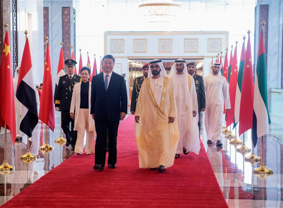 Chinese President Xi Jinping and his wife Peng Liyuan, accompanied by the United Arab Emirates (UAE) Vice President and Prime Minister Sheikh Mohammed bin Rashid Al Maktoum and the Crown Prince of Abu Dhabi Sheikh Mohammed bin Zayed Al Nahyan, head for a reviewing hall in Abu Dhabi, the UAE, July 19, 2018. Xi arrived here on Thursday for a state visit to the UAE. The UAE\'s vice president hosted a welcome ceremony for the Chinese president at the airport. (Xinhua/Li Xueren)