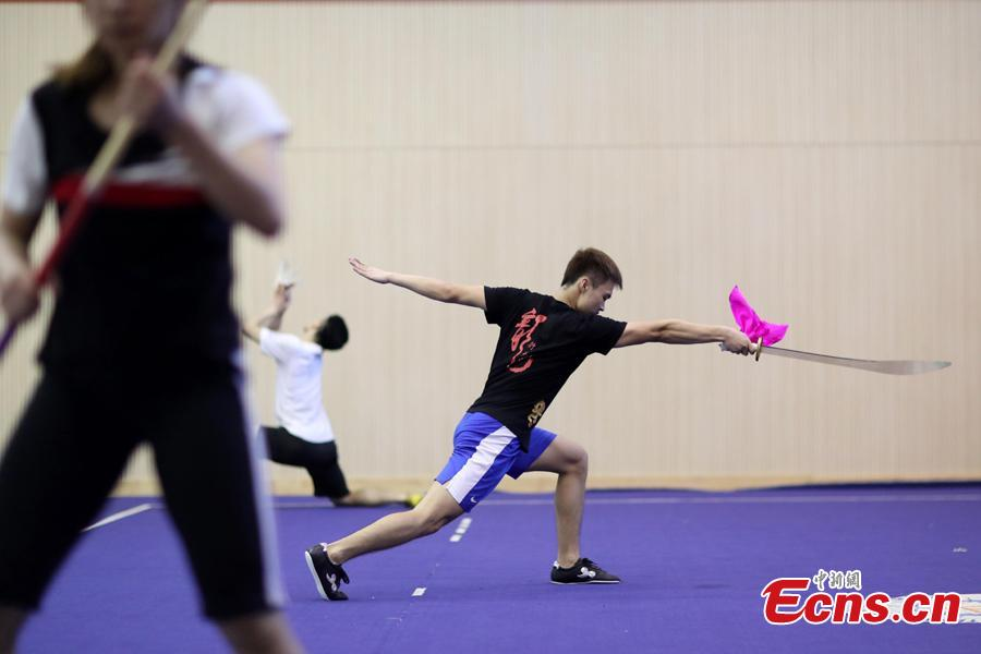 Members of the Nanjing Agricultural University Martial Arts Team train for the upcoming China University Students Martial Arts Routine Championship in Nanjing City, East China's Jiangsu Province, July 19, 2018, as temperatures hit approximately 35 degrees centigrade. (Photo: China News Service/Yang Bo)