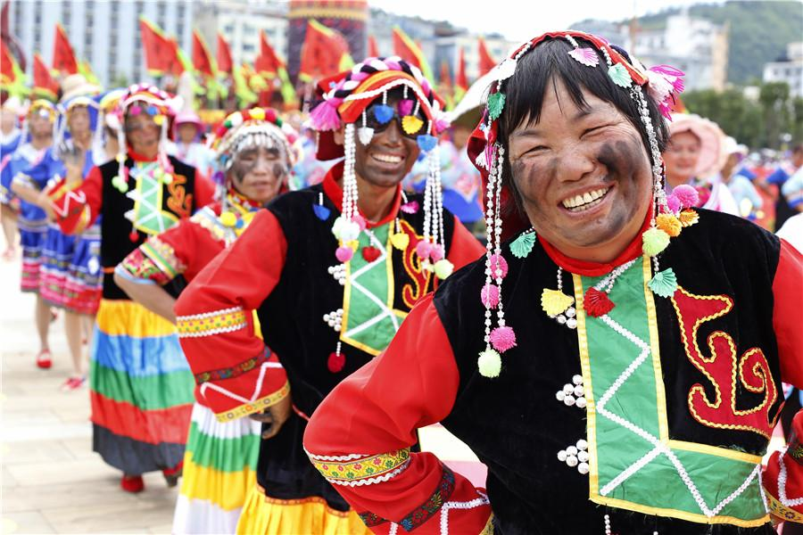 People celebrate black face festival in Qiubei county, Yunnan Province. (Photo/chinadaily.com.cn)